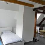 Wohnwerk41–Apartment8–Schlafbereich-und-Kueche